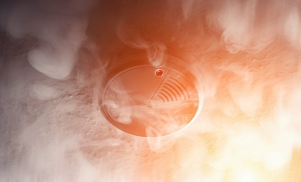 smoke detector with smoke around it